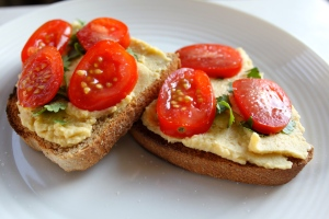 Spread homemade hummus over toasted Sourdough and finish with sliced cherry tomatoes, fresh basil and sea salt. Very quick.